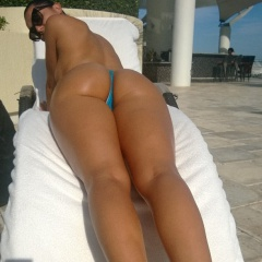 half naked babe wears only a thong and gets a tan by the pool #naked #thong #babe #sexy